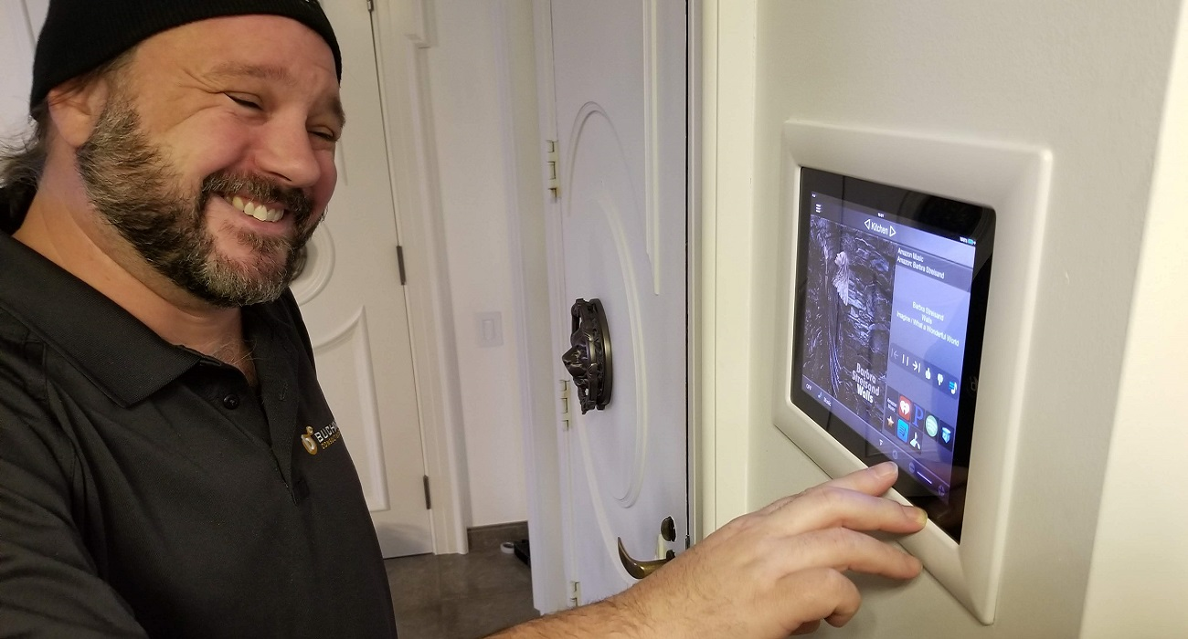 Buchan Consulting LLC's Rick Lyons working on Elan Home Automation in Watertower Place Condominiums